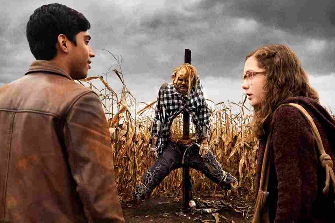 Michael Garza and Zoe Colletti with the scarecrow in Scary Stories to Tell in the Dark (2019)