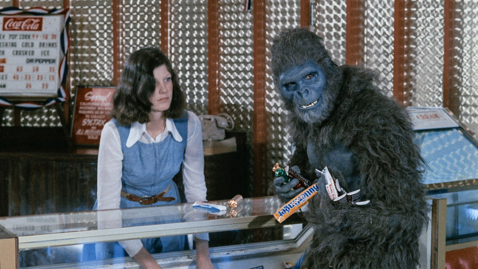 The Schlockthropus (John Landis) goes to the movies in Schlock (1973)