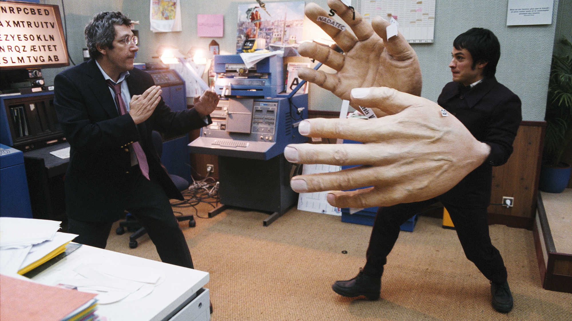 Gael Garcia Bernal (r) has a dream in which he has giant hands, along with co-worker Alain Chabat (l) in The Science of Sleep (2006)