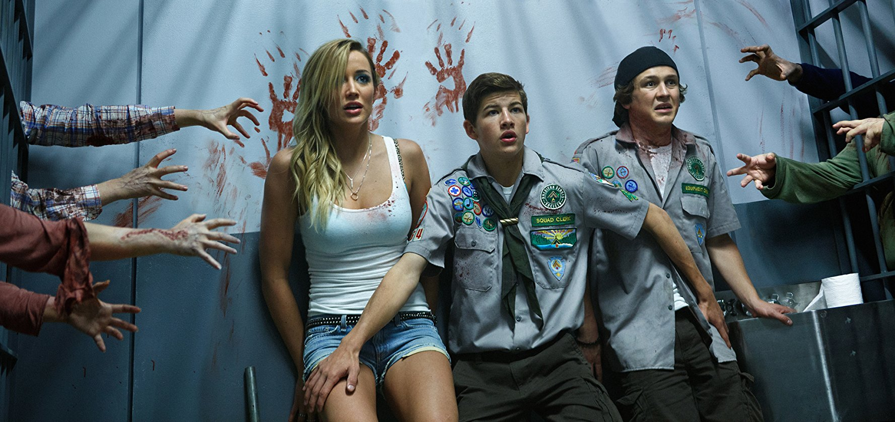 At siege from the zombies - (l to r) Sarah Dumont, Tye Sheridan, Logan Miller in Scouts Guide to the Zombie Apocalypse (2015)
