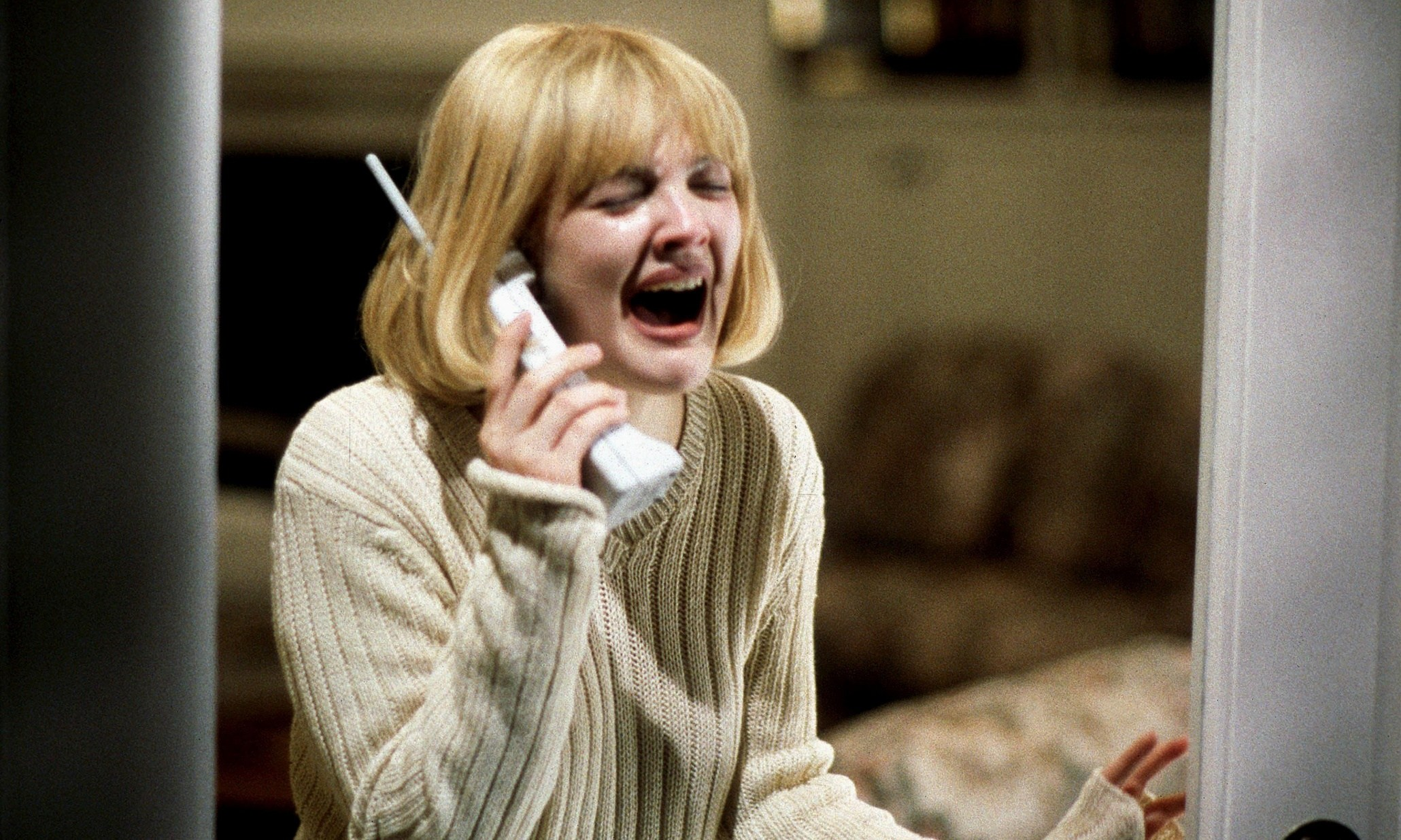 Drew Barrymore answers the phone in the classic opening scene in Scream (1996)