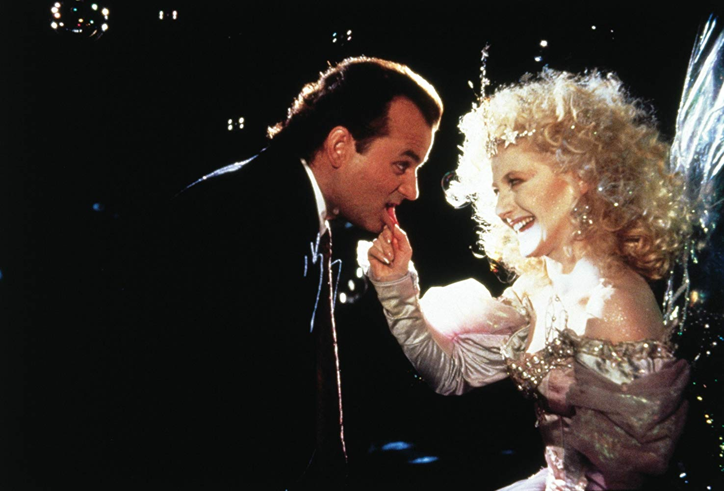 Bill Murray meets the Ghost of Christmas Present (Carol Kane) in Scrooged (1988)