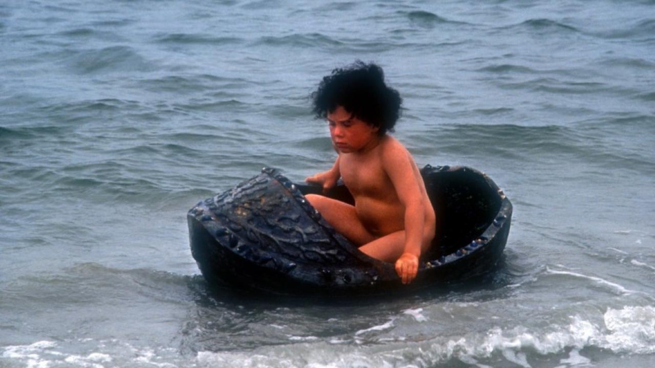 Young Jamie (Cillian Byrne) afloat in his crib in The Secret of Roan Inish (1994)