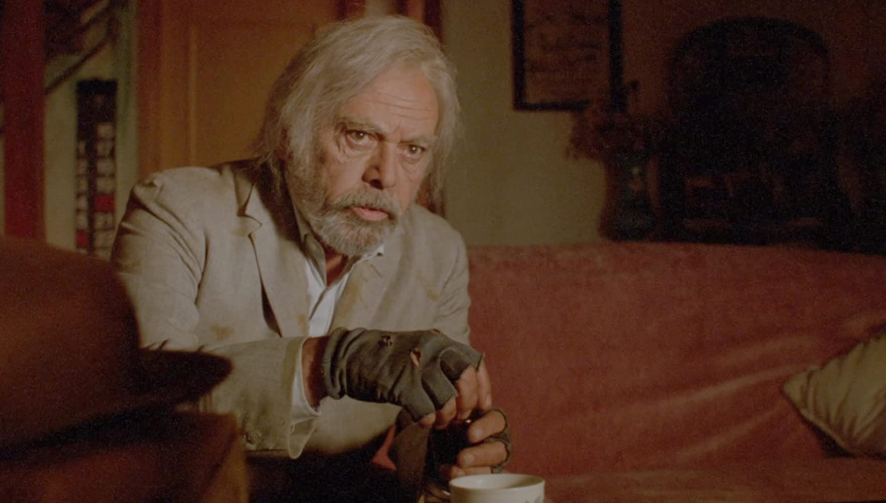Herbert Lom as occultist Moebius Kelly in The Sect (1991)