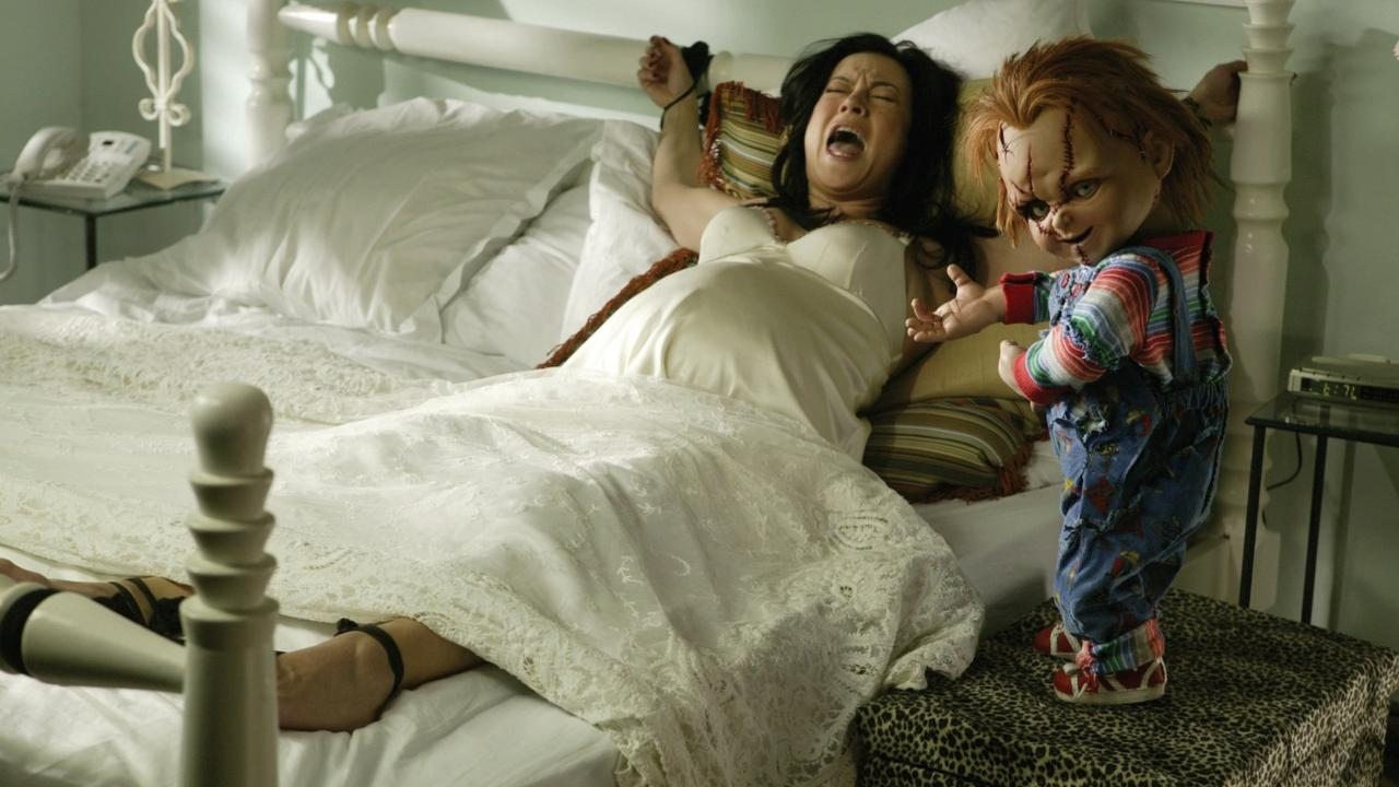 Chucky threatens actress Jennifer Tilly (playing herself) in Seed of Chucky (2004)