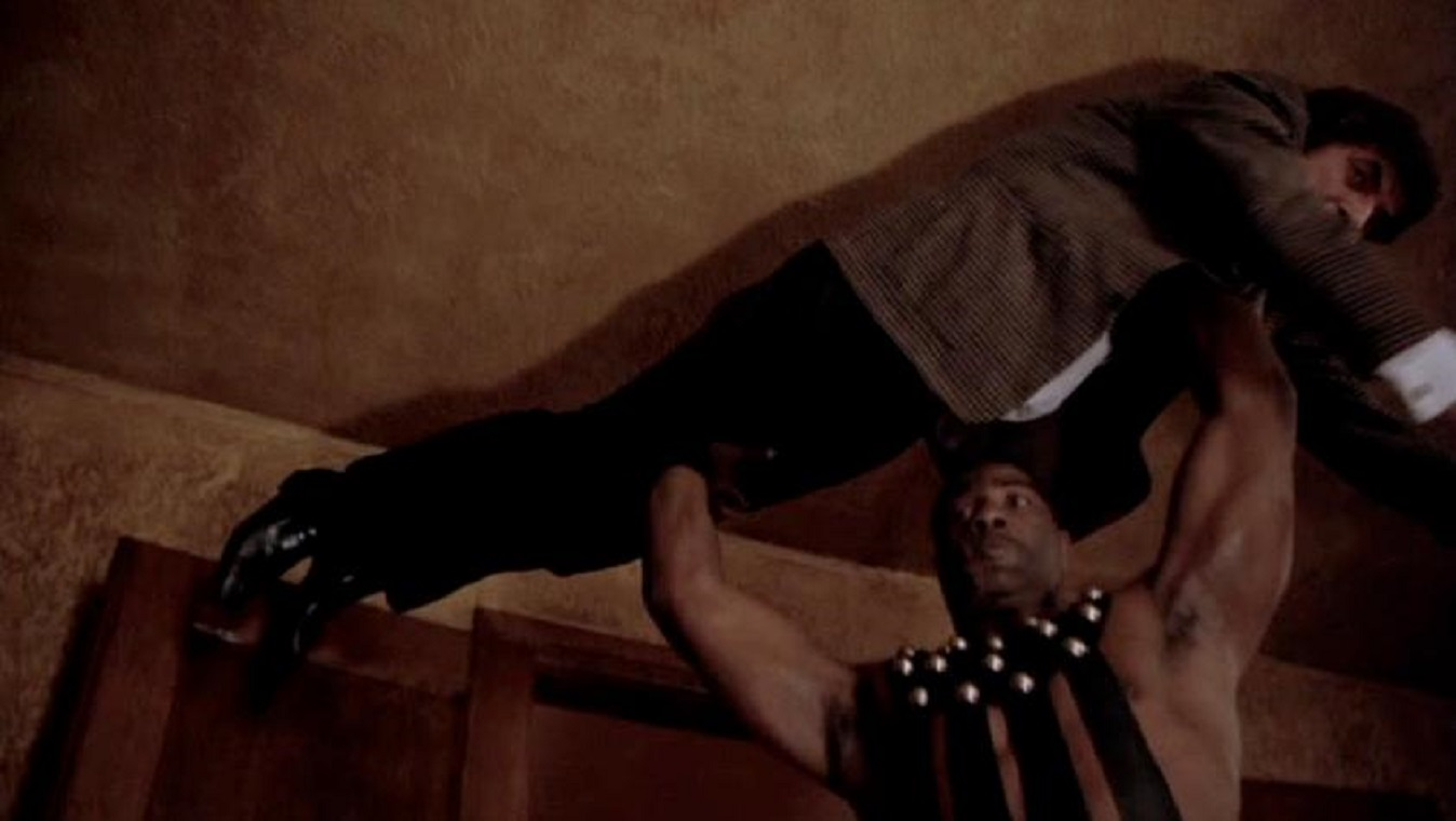 Writer Jonathan Frid is picked up by the nightmare figure of The Jackal (Henry Baker) in Seizure (1974)
