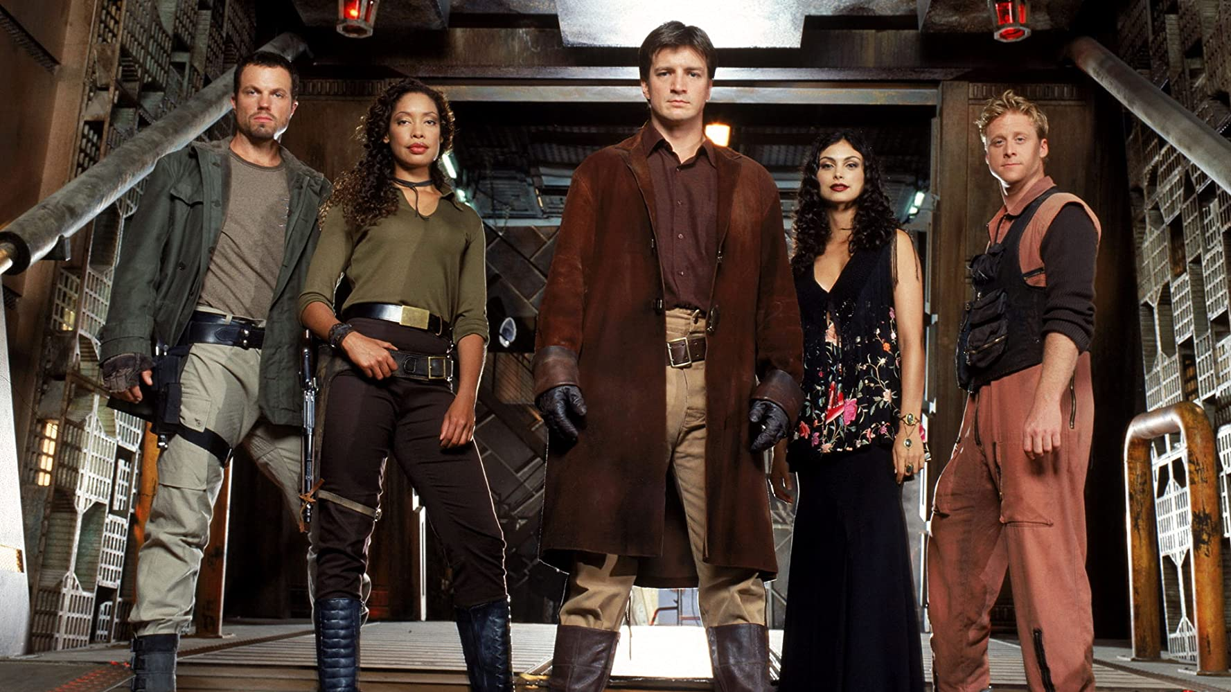 Jayne Cobb (Adam Baldwin), Zoe (Gina Torres), Captain Malcolm Reynolds (Nathan Fillion), Inara Serra (Morena Baccarin) and Wash Washburne (Alan Tudyk) in Serenity (2005)