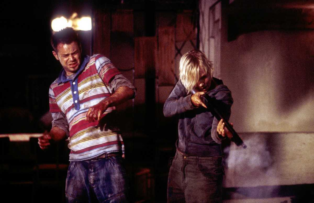 The team-building exercise becomes a brutal fight for survival - (l to r) Danny Dyer and Laura Harris in Severance (2006)