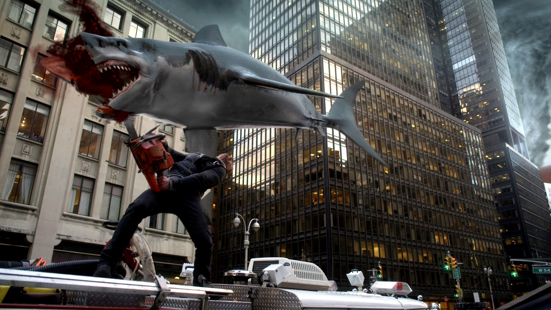 Ian Ziering and chainsaw vs shark in the streets of New York City in Sharknado 2 The Second One (2014)