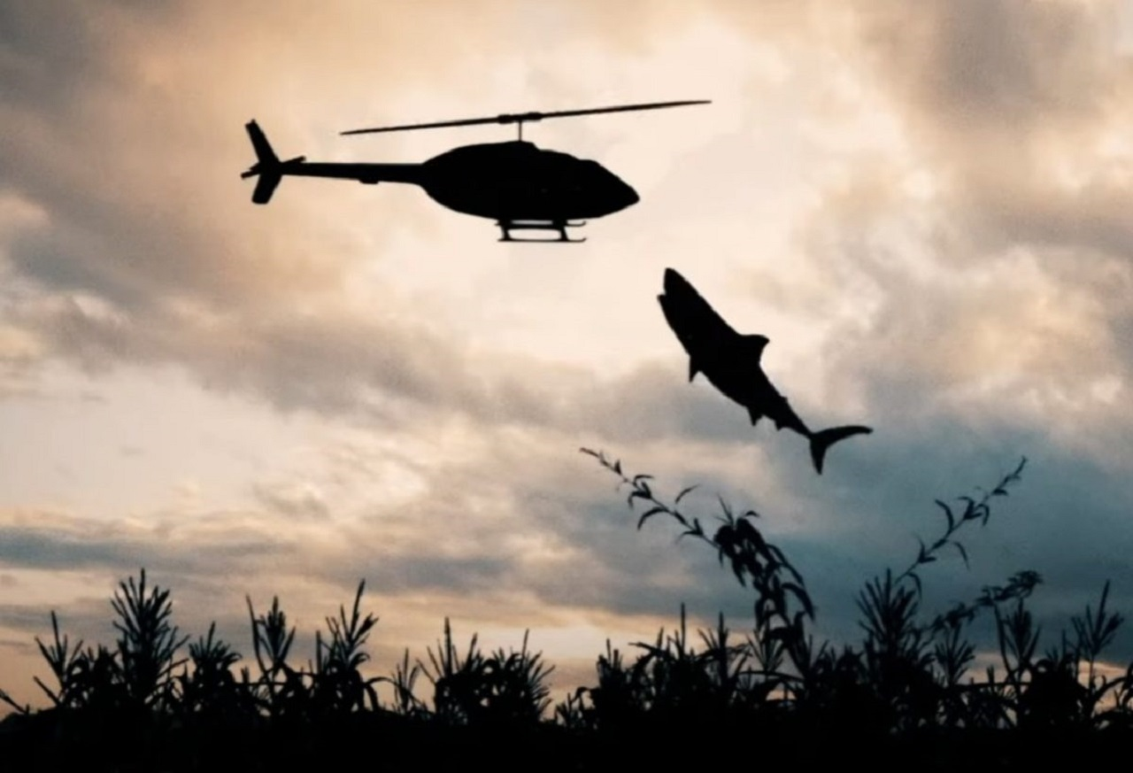 A shark jumps out of the cornfield in Sharks of the Corn (2021)