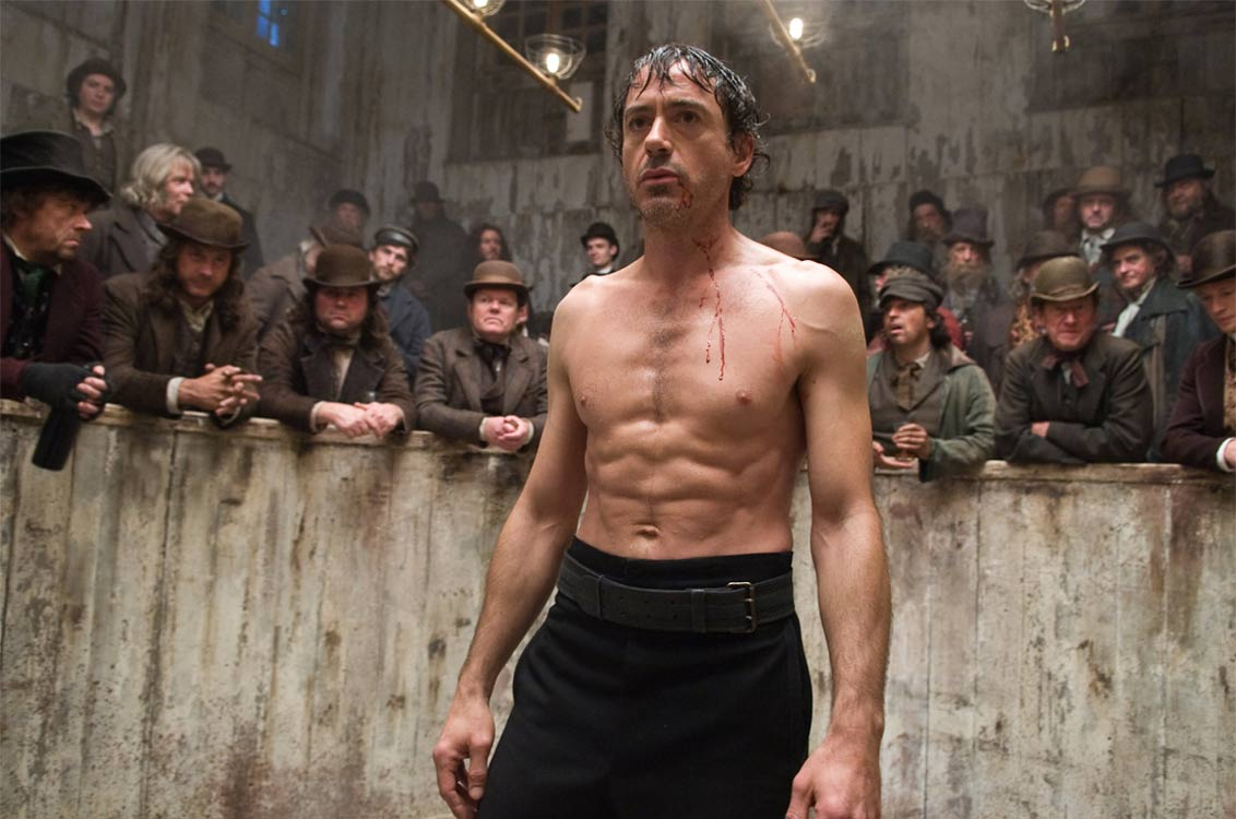 Sherlock Holmes (Robert Downey Jr) engaged in bare-knuckle boxing atches in Sherlock Holmes (2009)