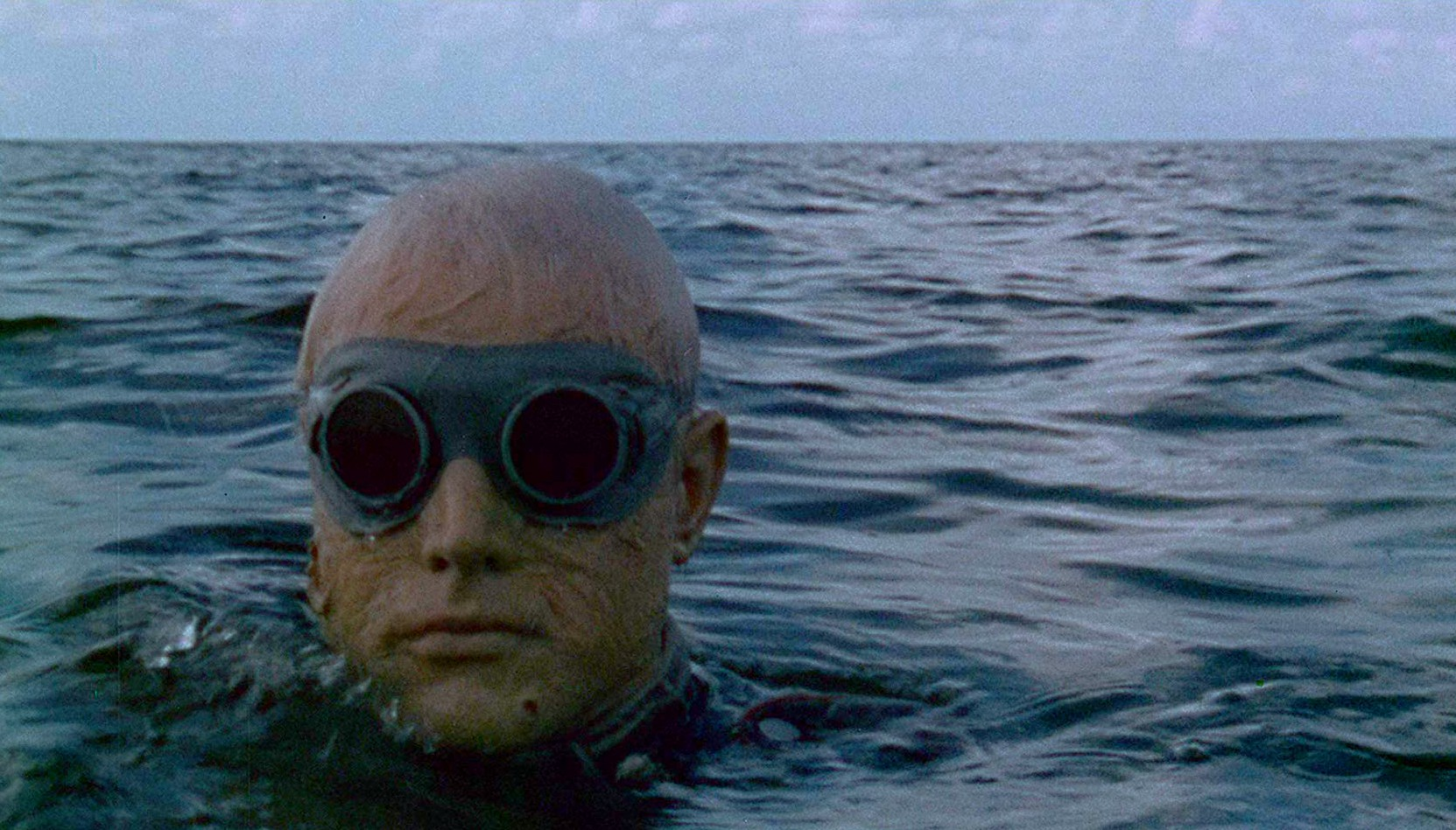 A Nazi zombie rises from the surf in Shock Waves (1977)