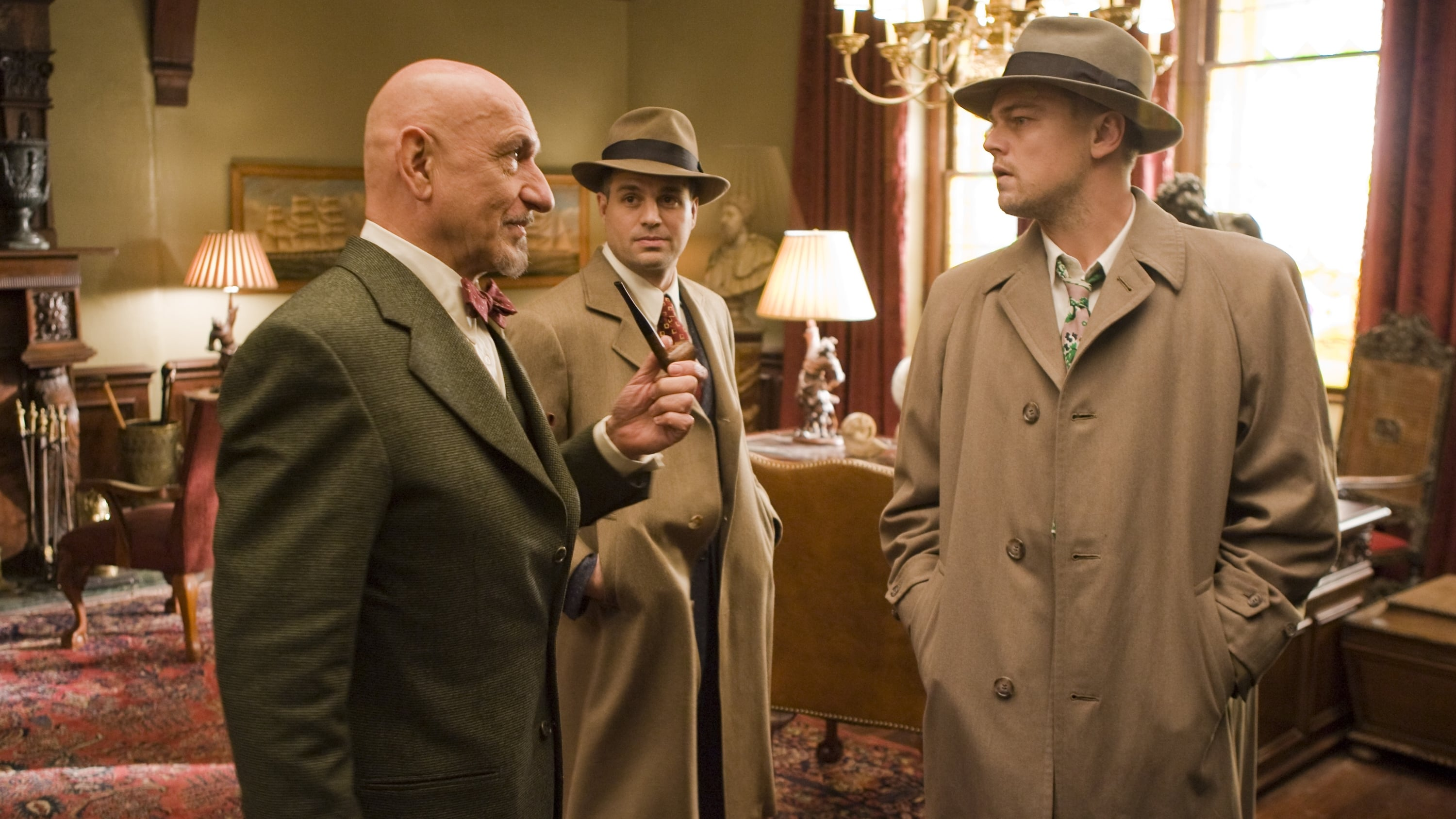 Federal marshal Teddy Daniels (Leonardo DiCaprio) and partner Chuck Aule (Mark Ruffalo) question asylum head Dr Cawley (Ben Kingsley) in Shutter Island (2010)