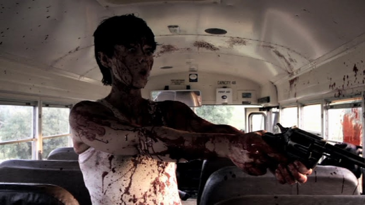 Leslie Andrews shoots everybody aboard the bus in Sick Girl (2007)
