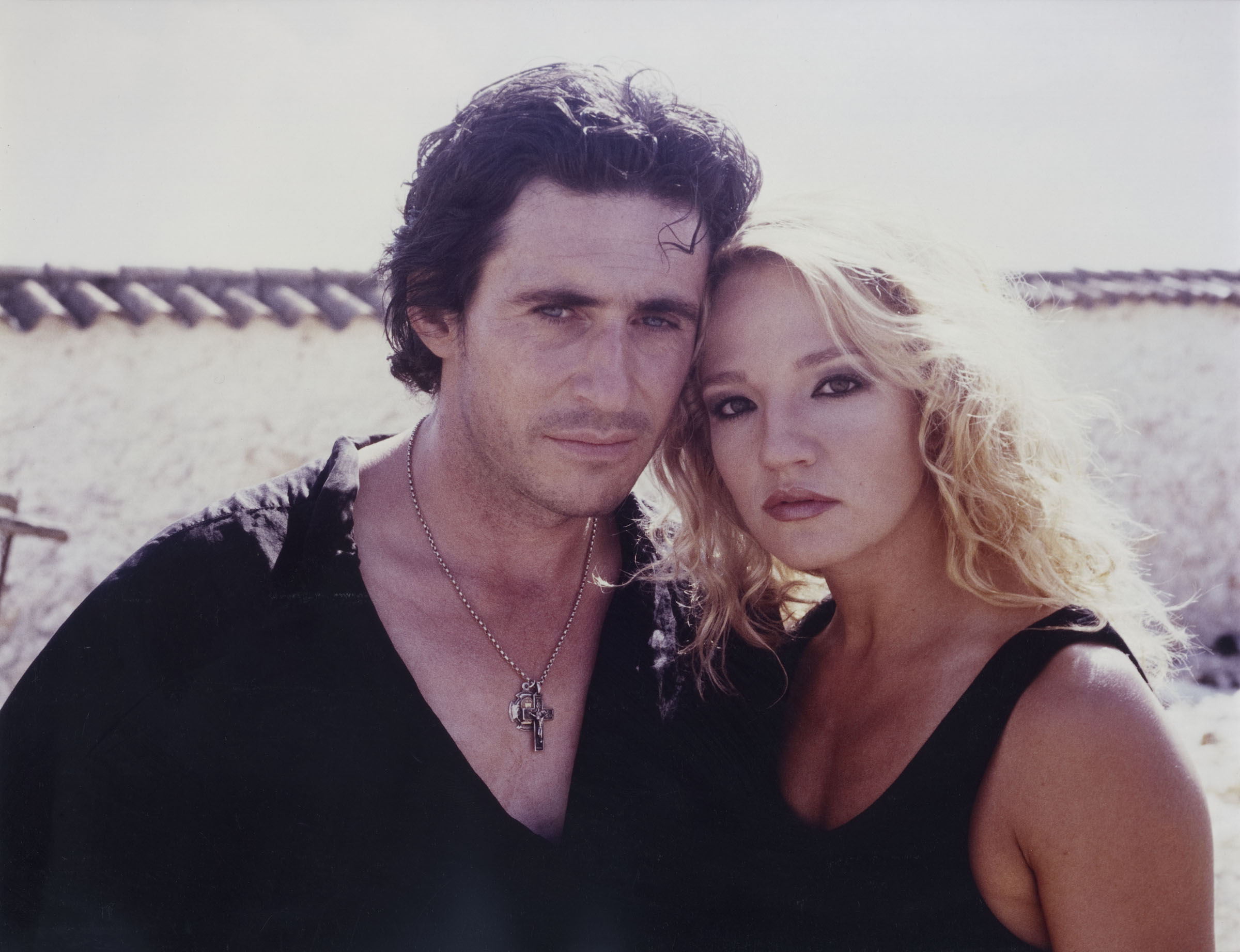 Ellen Barkin as Claire, a stunwoman passing through a series of strange adventures, and her Spanish lover Gabriel Byrne in Siesta (1987)