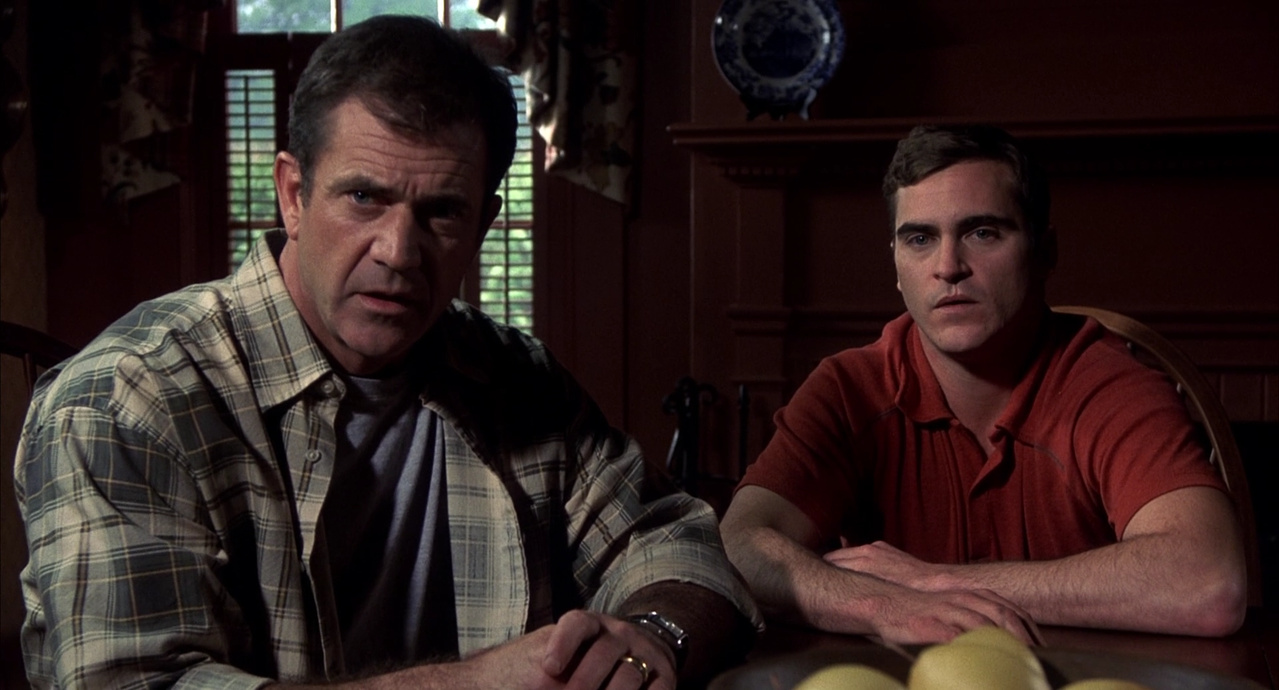 Mel Gibson and his brother Joaquin Phoenix in Signs (2002)