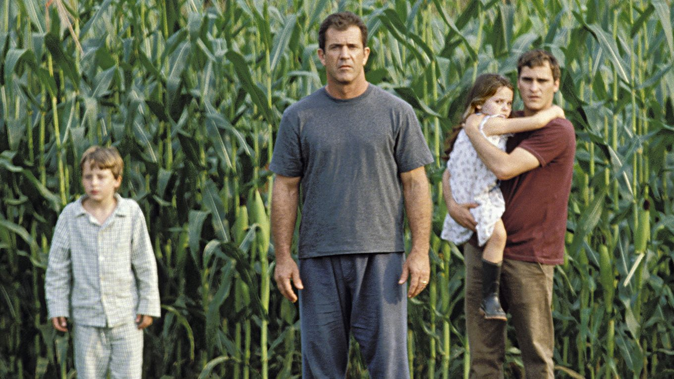 Mel Gibson and Joaquin Phoenix with children Rory Culkin and Abigail Breslin investigate what is happening in the cornfield in Signs (2002)