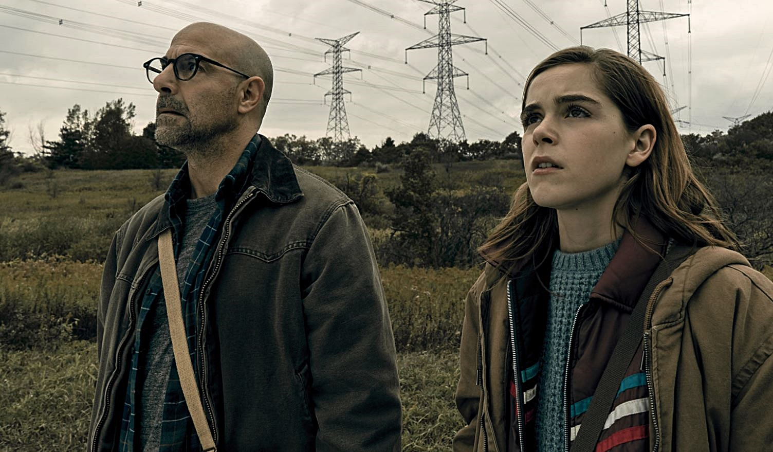 Father and daughter Stanley Tucci and Kiernan Shipka unable to make a noise lest they be attacked by creatures in The Silence (2019)