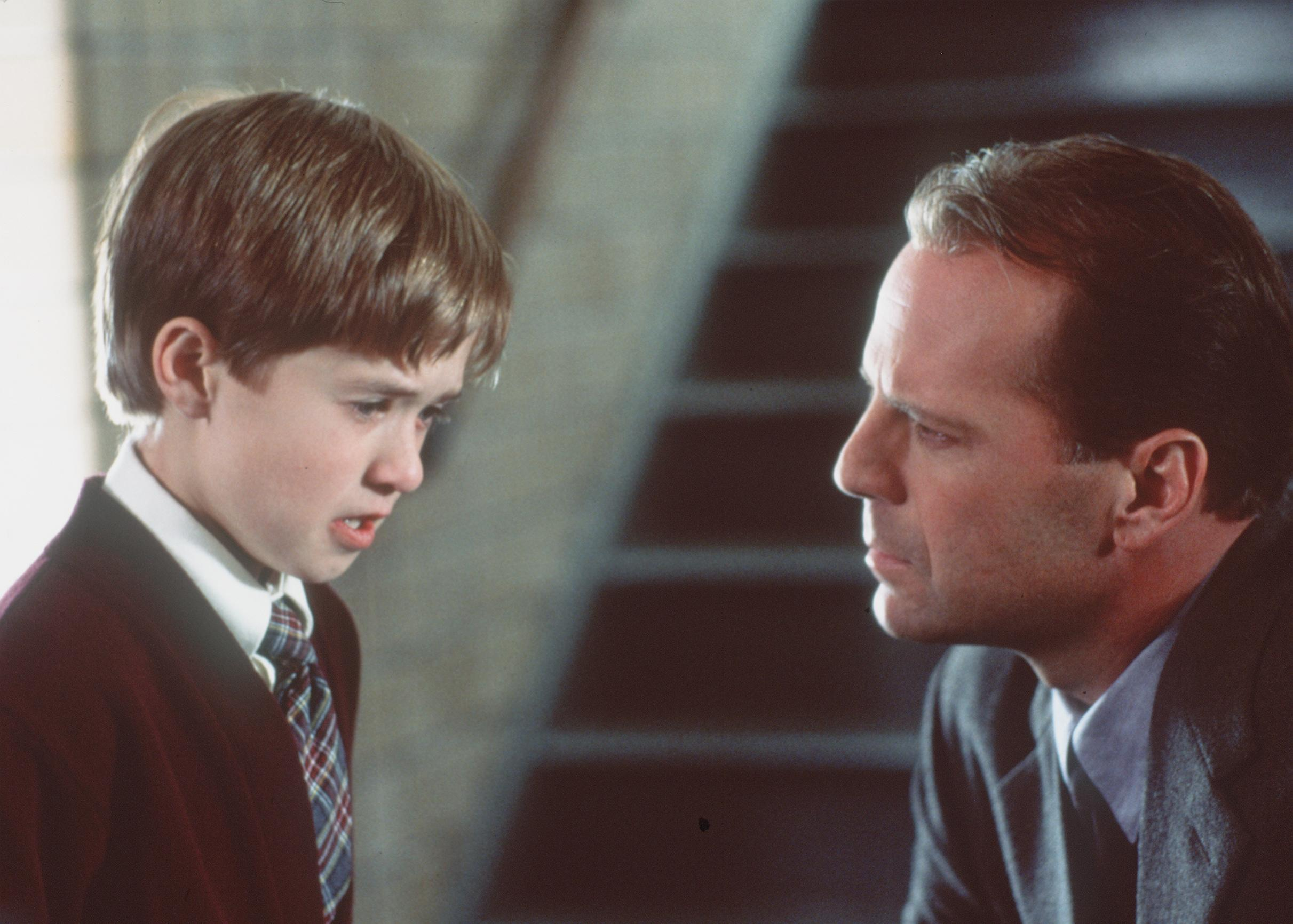 Psychologist Bruce Willis dealing with Haley Joel Osment as a child who insists he can see ghosts in The Sixth Sense (1999)