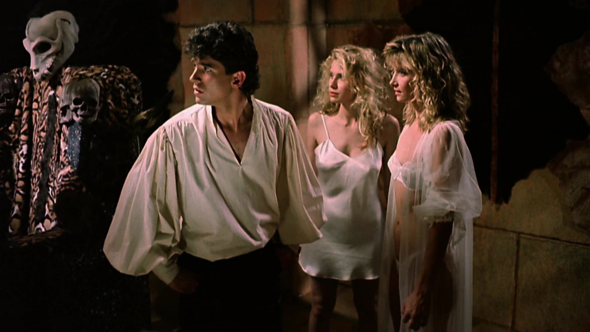 (l to r) Zed (Don Scribner), Dara (Elizabeth Cayton, later known as Elizabeth Kaitan) and Tisa (Cindy Beal) in Slave Girls from Beyond Infinity (1987)