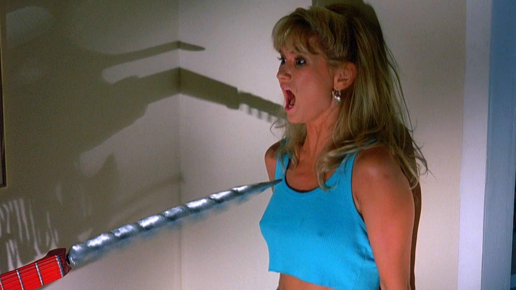 Heidi Kozak threatened by The Driller Killer in Slumber Party Massacre II (1987)