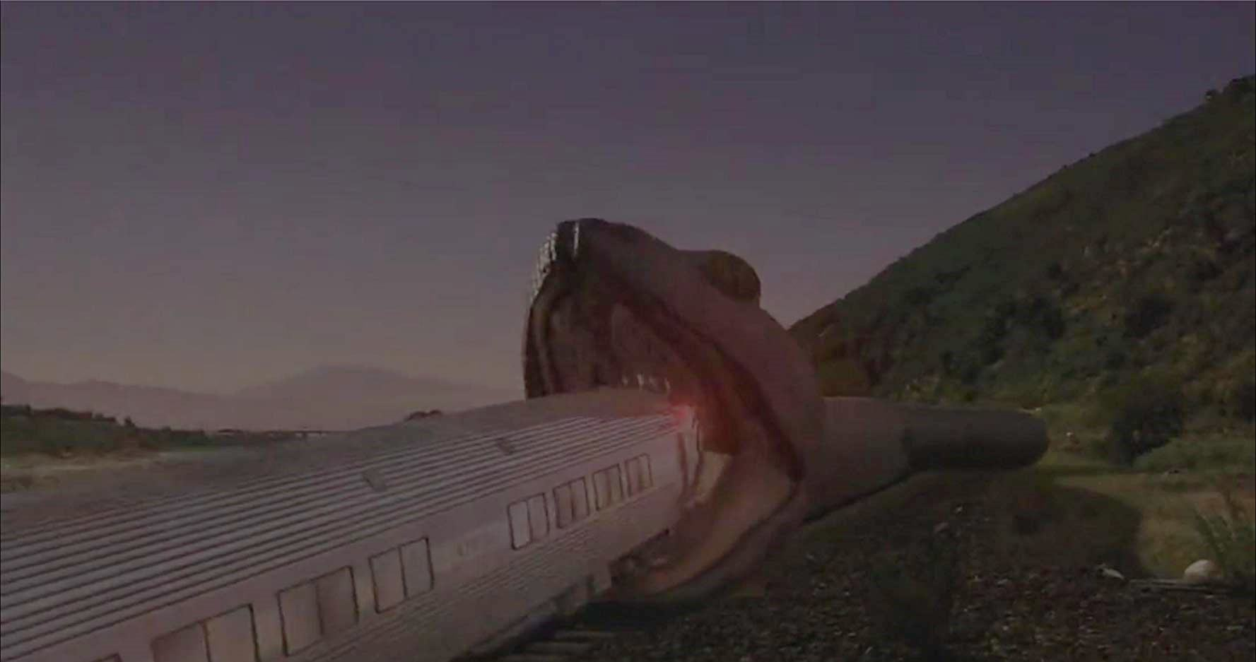 A giant snake tries to devour the train in Snakes on a Train (2006)