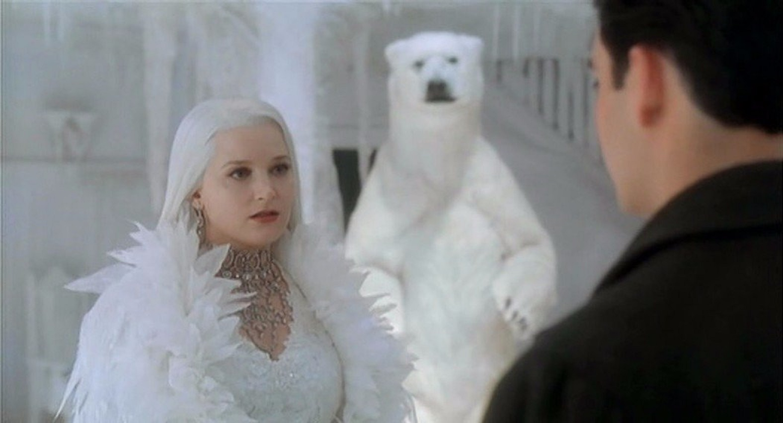 Bridget Fonda as The Snow Queen with loyal polar bear servant in Snow Queen (2002)