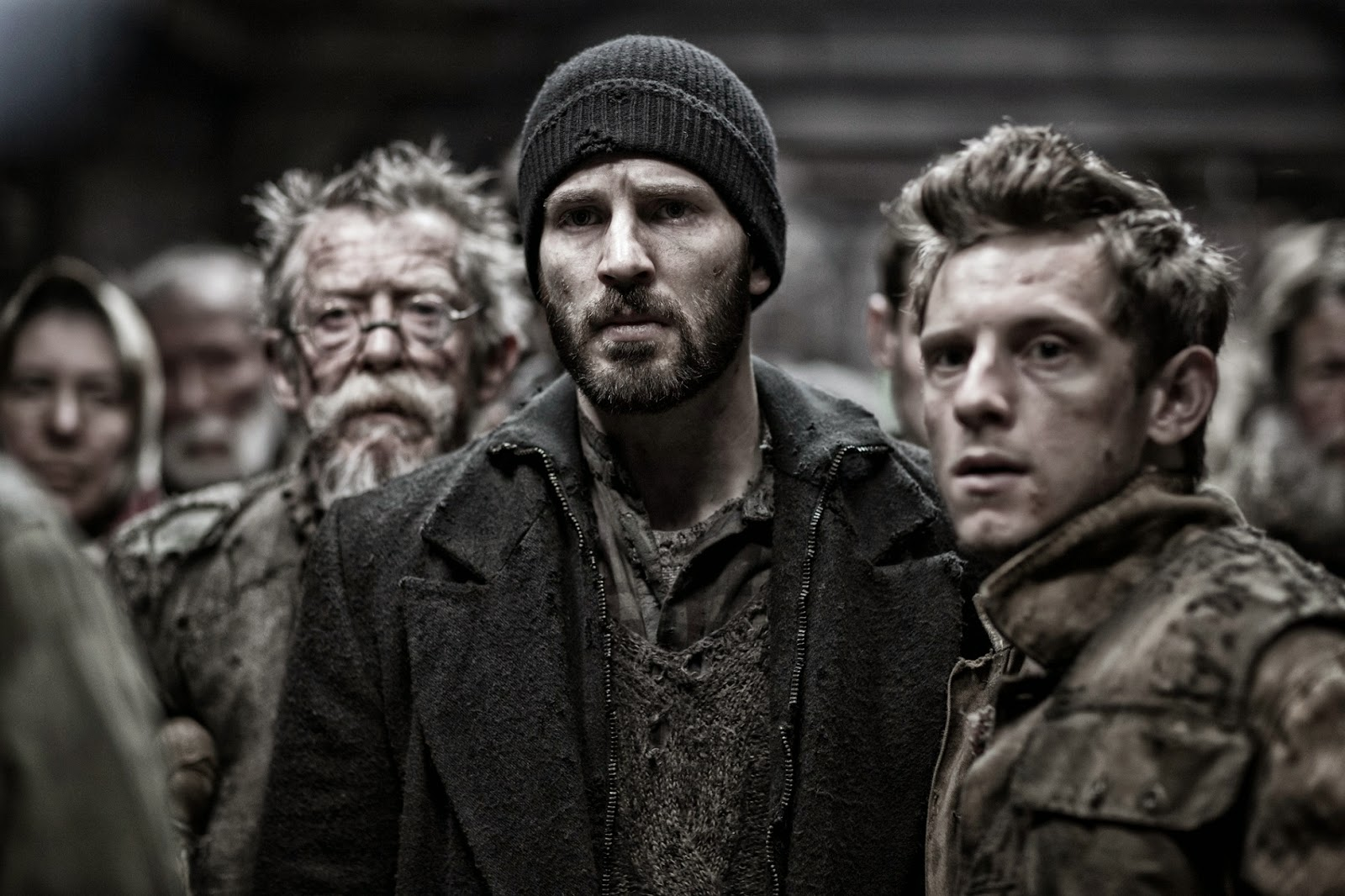 John Hurt, Chris Evans and Jamie Bell plot revolution in the tail compartments in Snowpiercer (2013)