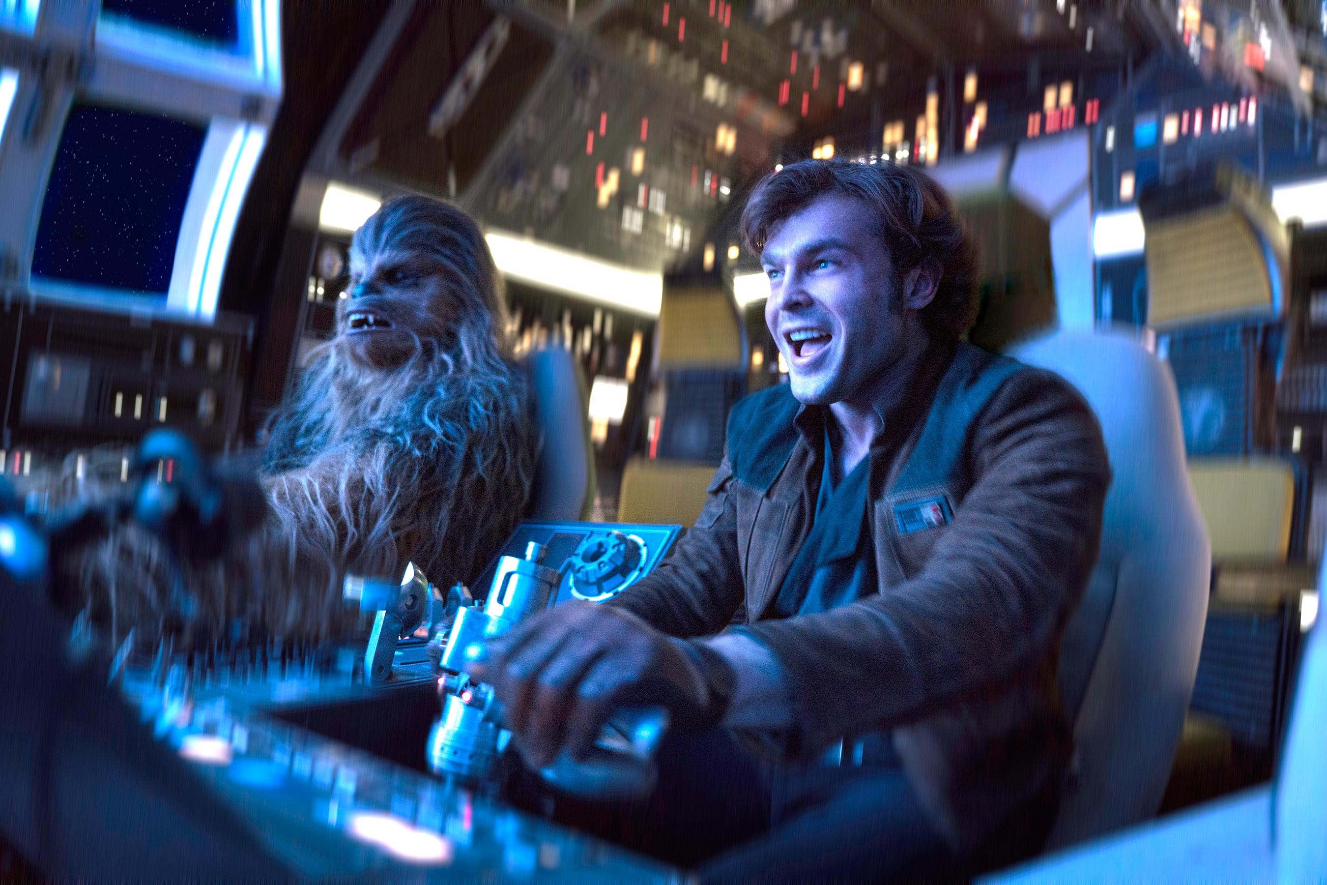 Chewbacca (Joonas Suotamo) and Han Solo (Alden Ehrenreich) pilot the Millennium Falcon for the first time in Solo: A Star Wars Story (2018)