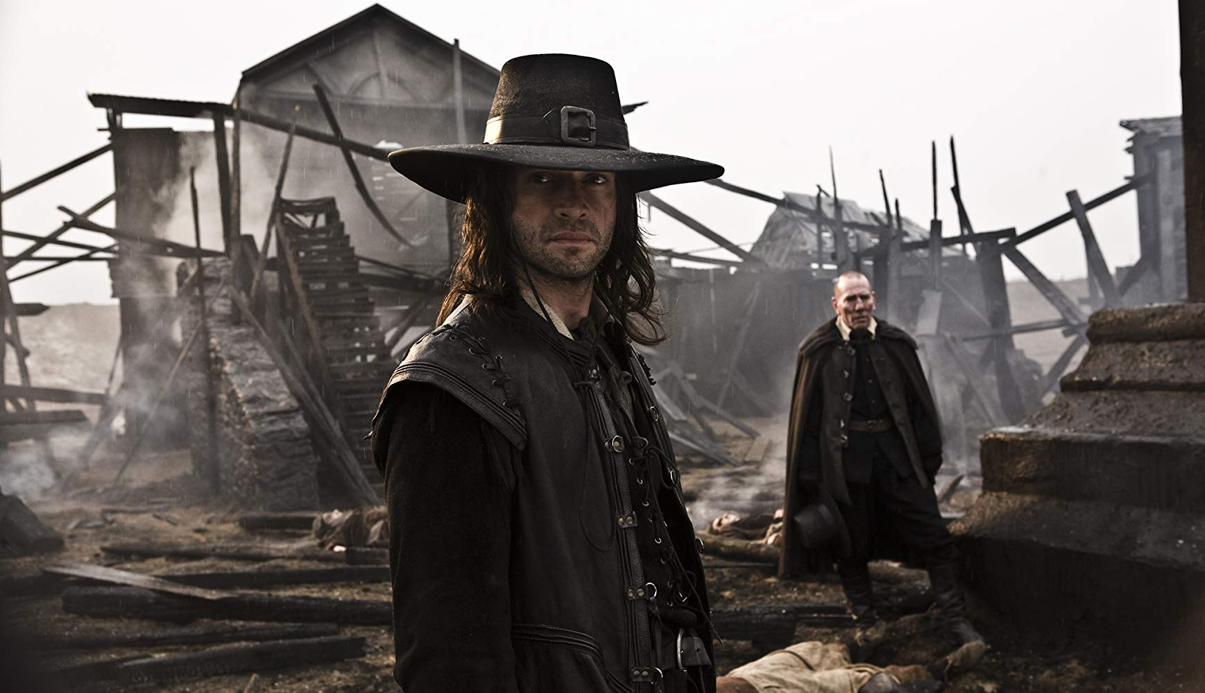 James Purefoy as Robert E. Howard's Puritan warrior Solomon Kane with Pete Postlethwaite in the background in Solomon Kane (2009)