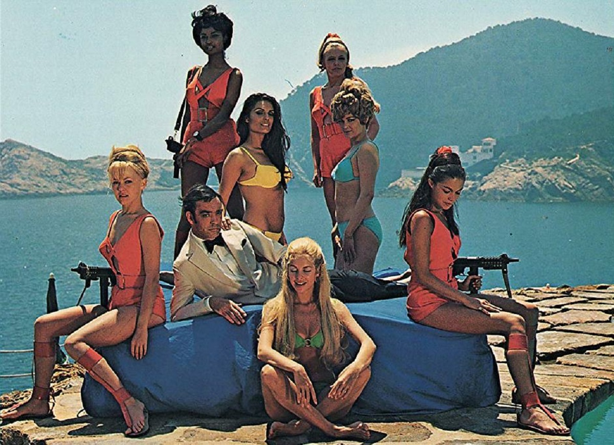 Hugh Drummond (Richard Johnson) relaxes amid a group of the women with robot brains in Some Girls Do (1969)