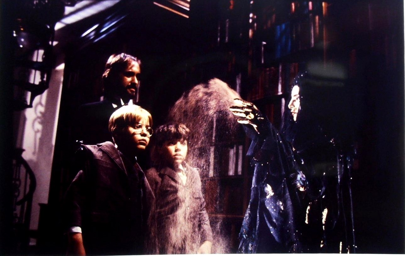 Mr Dark (Jonathan Pryce) gives Will (Vidal I. Peterson) and Jim (Shawn Carson) to the Dust Witch (Pam Grier) in Something Wicked This Way Comes (1983)