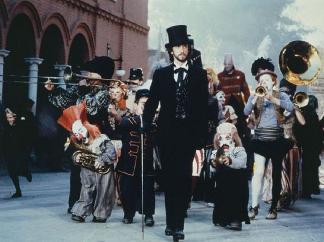 Dark's Pandemonium Carnival, led by Mr Dark (Jonathan Pryce), arrives in town in Something Wicked This Way Comes (1983)