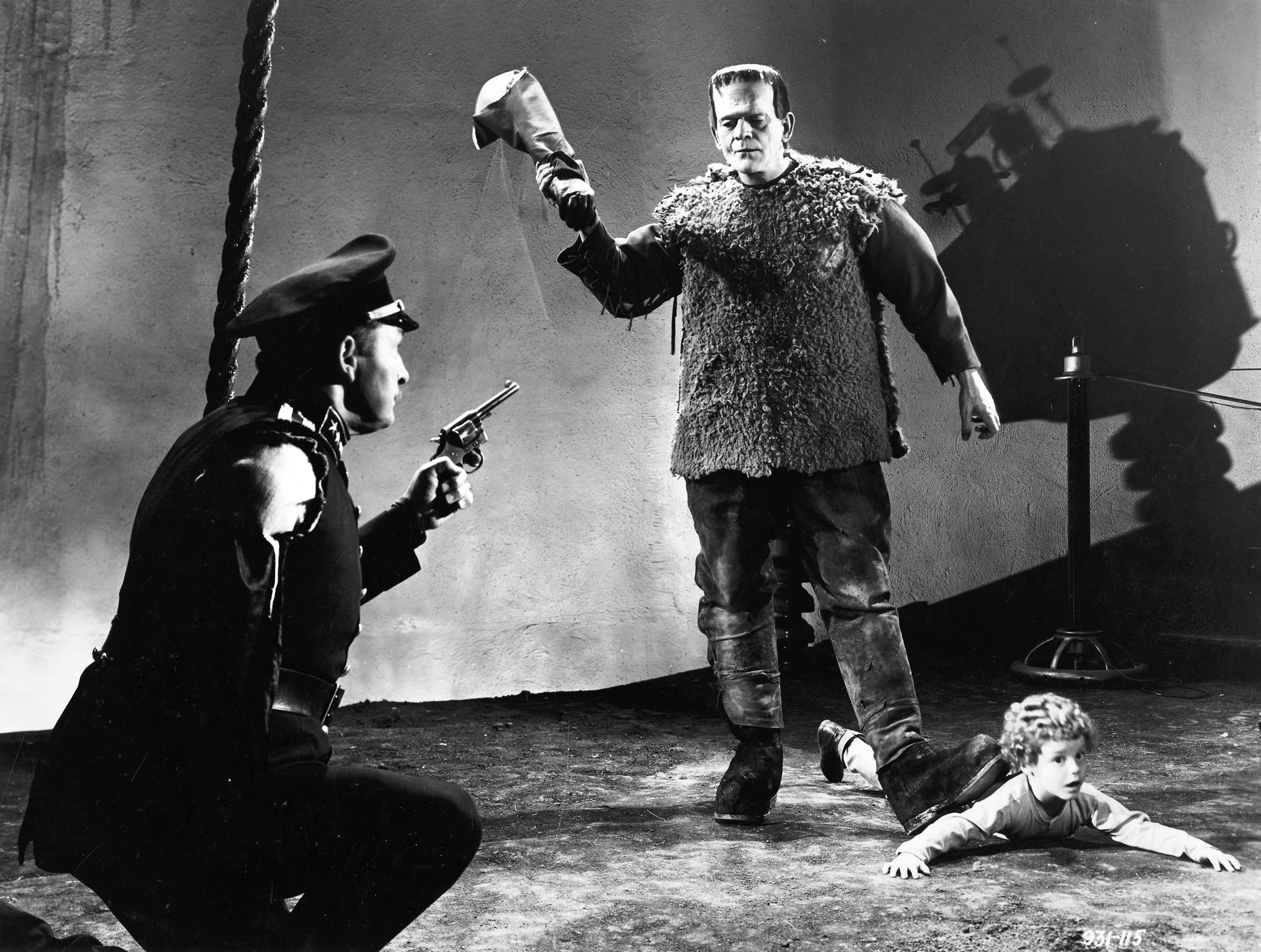 (l to r) Inspector Krogh (Lionel Atwill) attempts to stop the monster (Boris Karloff) as it threatens Frankenstein's son (Donnie Duggan) in Son of Frankenstein (1939)