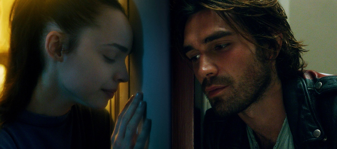 Lovers separated by quarantine - Sofia Carson and K.J. Apa in Songbird (2020)