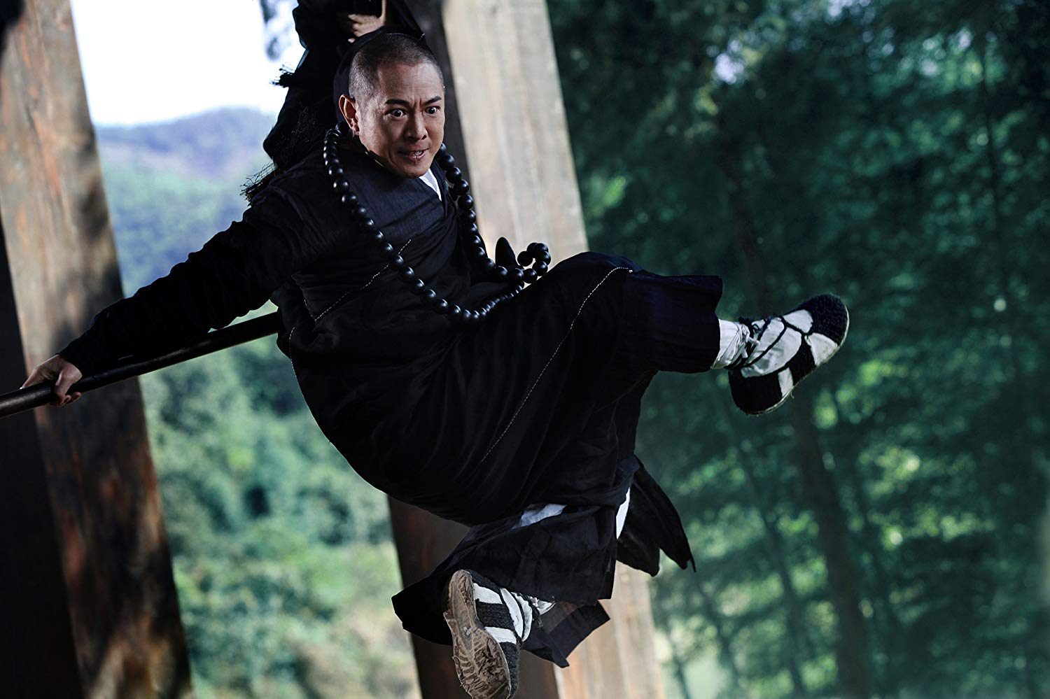 Jet Li as Abbot Fahai on a mission to hunt demons in The Sorcerer and the White Snake (2011)