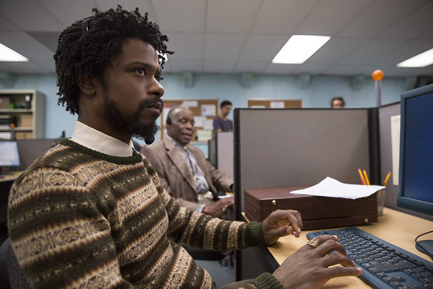 Cassius Green (Lakeith Stanfield) takes a job telemarketing in Sorry to Bother You (2018)