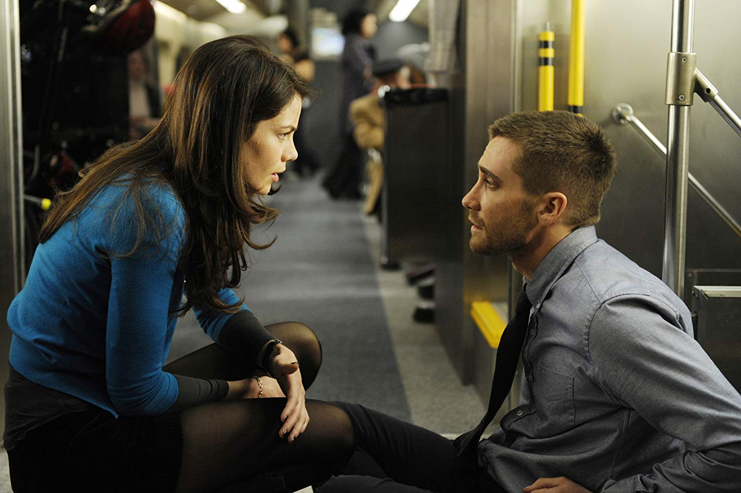 Jake Gyllenhaal aboard a train with Michelle Monaghan where he is forced to relive the same eight minutes over again to find a bomb in Source Code (2011)