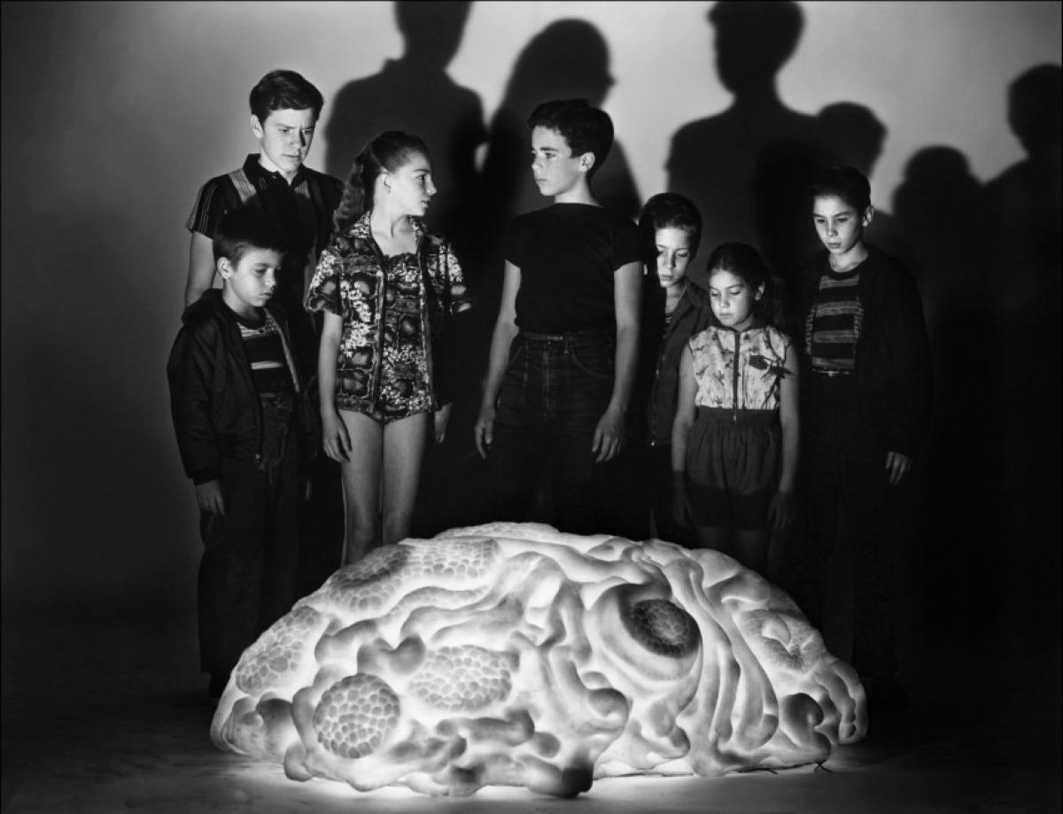 The children gathered around the alien blob in The Space Children (1958)