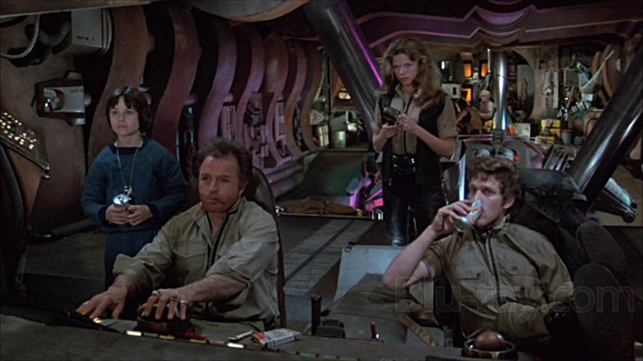 (l to r) Intergalactic runaway Peter (David Mendenhall), Hawk (Vince Edwards) and his crew Patsy Pease and Luca Bercovici in Space Raiders (1983)