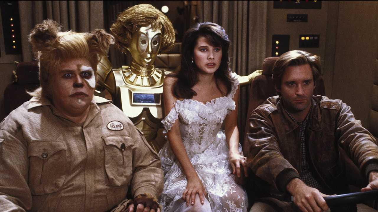 Barf (John Candy), Dot Matrix (Lorene Yarnell, voiced by Joan Rivers), Princess Vespa (Daphne Zuniga) and Lone Starr (Bill Pullman) in Spaceballs (1987)