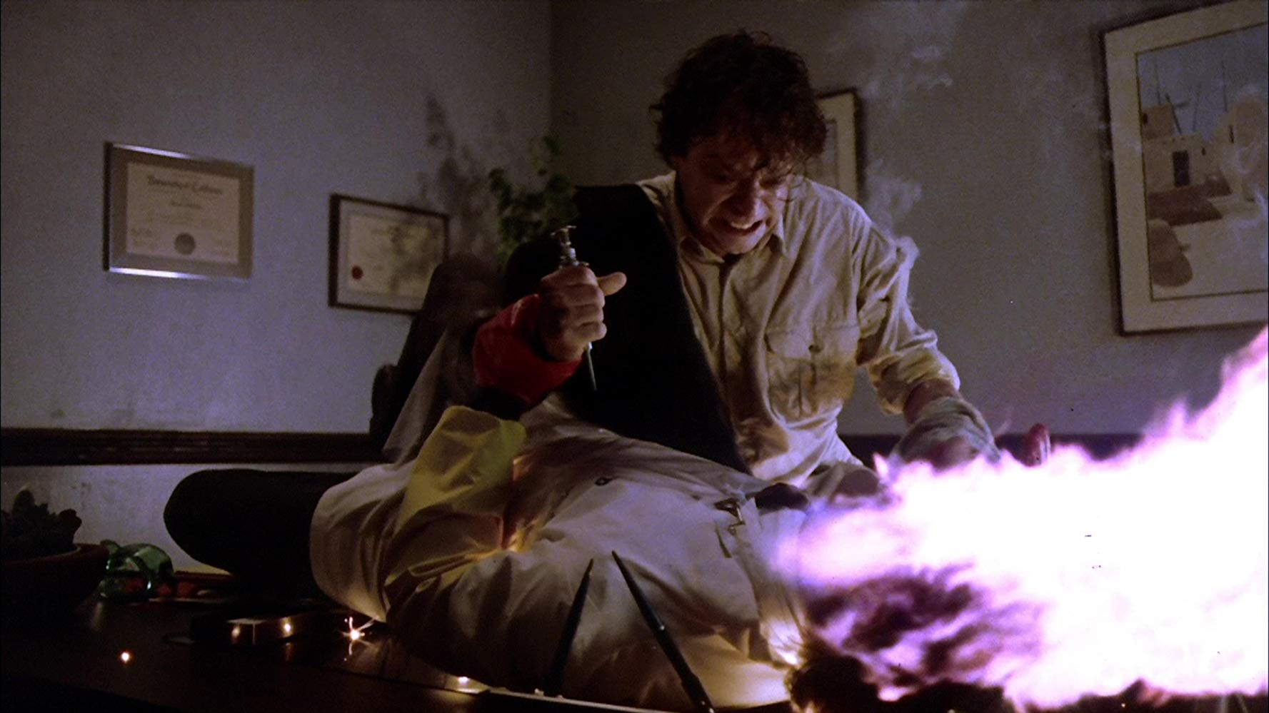 Pyrokinetic Brad Dourif causes a victim's head to explode in Spontaneous Combustion (1990)