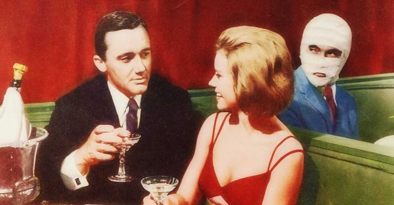 Napoleon Solo (Robert Vaughn) with girlfriend Sharon Farrell as the surgical double looks on in The Spy With My Face (1965)