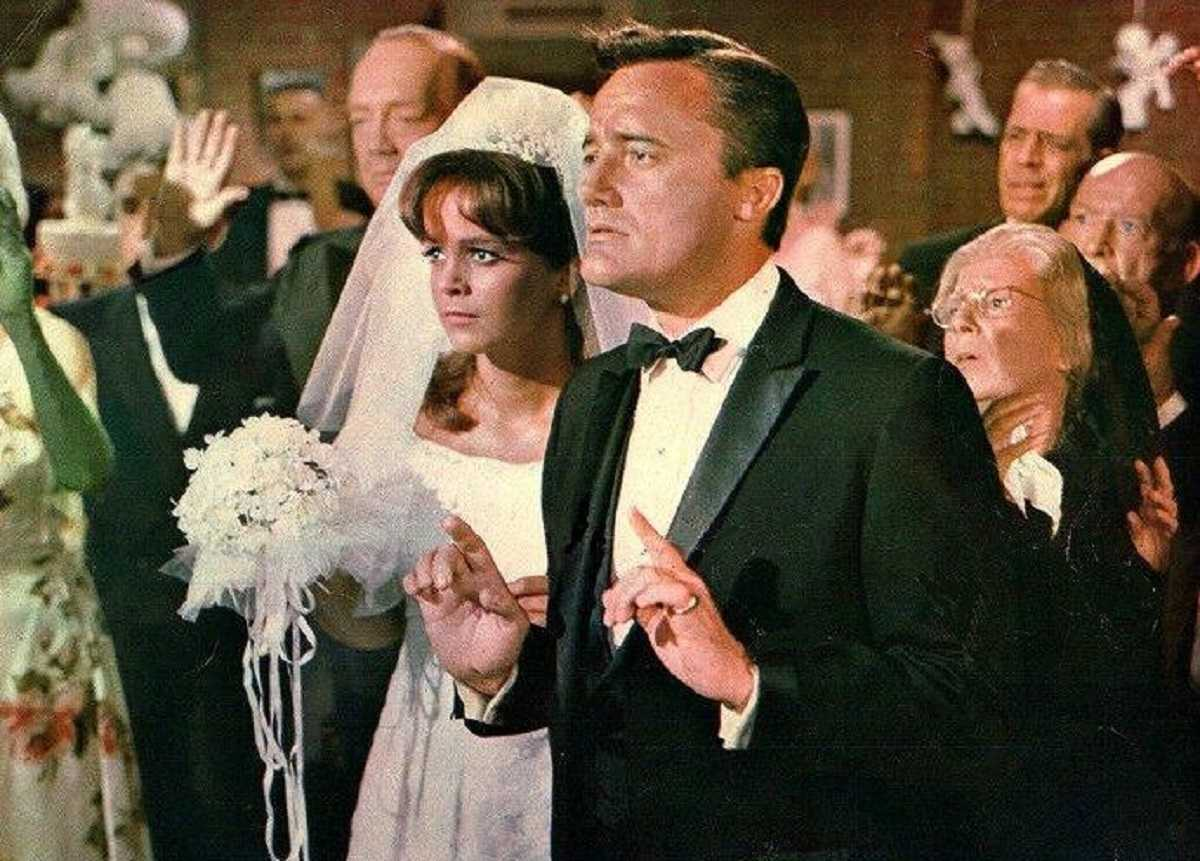 Napoleon Solo (Robert Vaughn) forced into a shotgun wedding to Letitia Roman in The Spy in the Green Hat (1967)