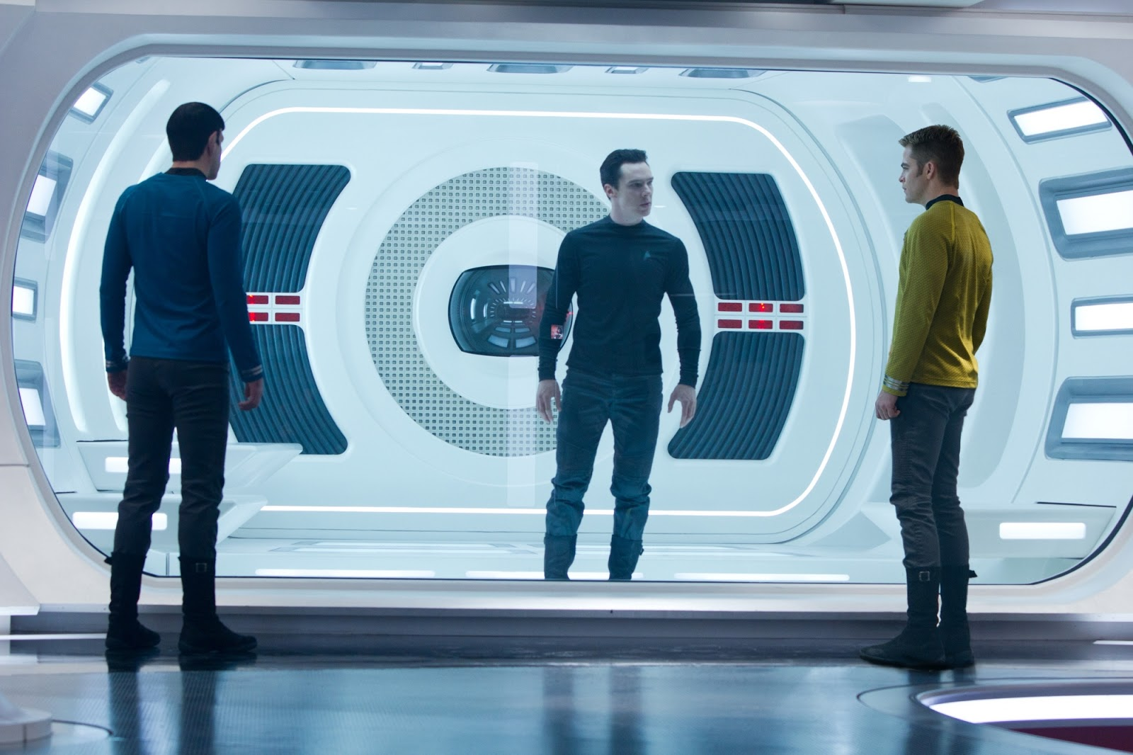 Spock (Zachary Quinto) and Captain Kirk (Chris Pine) confront an imprisoned Khan (Benedict Cumberbatch) in Star Trek Into Darkness (2013)