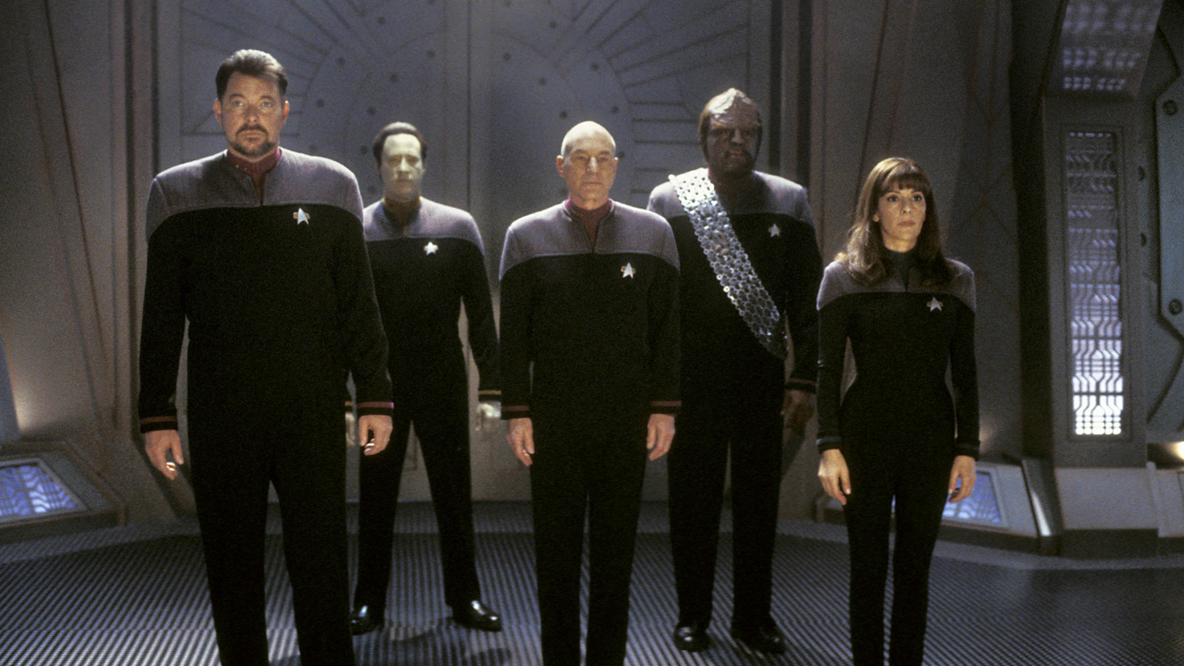 The Enterprise crew beam into action - Commander Riker (Jonathan Frakes), Data (Brent Spiner), Captain Picard (Patrick Stewart), Worf (Michael Dorn) and Counselor Troi (Marina Sirtis) © Paramount Pictures in Star Trek: Nemesis (2002)