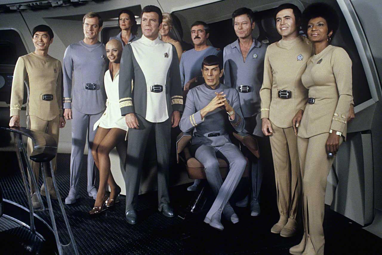 Cast line-up - Sulu (George Takei), Willard Decker (Stephen Collins), Lieutenant Ilia (Persis Khambatta), Christine Chapel (Majel Barrett), Admiral Kirk (William Shatner), Janice Rand (Grace Lee Whitney), Mr Scott (James Doohan), Spock (Leonard Nimoy), Dr McCoy (DeForest Kelley), Chekov (Walter Koenig) and Uhura (Nichelle Nichols) in Star Trek - The Motion Picture (1979)