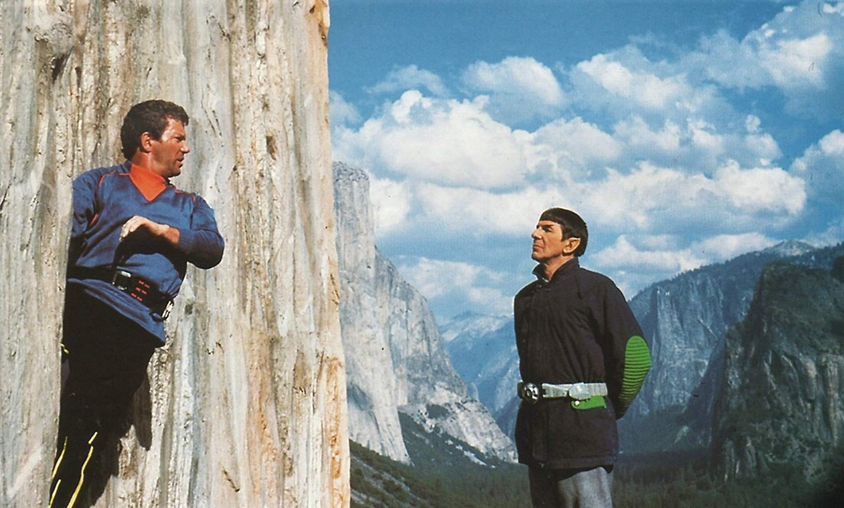 Spock (Leonard Nimoy) wearing jetboots comes to Captain Kirk (William Shatner)'s aid as he climbs El Capitane in Star Trek V: The Final Frontier (1989)