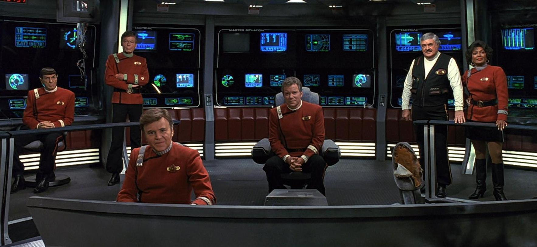 The Enterprise crew together again for one last outing - Mr Spock (Leonard Nimoy), Dr McCoy (DeForest Kelley), Chekov (Walter Koeenig), Captain Kirk (William Shatner), Mr Scott (James Doohan) and Uhura (Nichelle Nichols) in Star Trek VI: The Undiscovered Country (1991)
