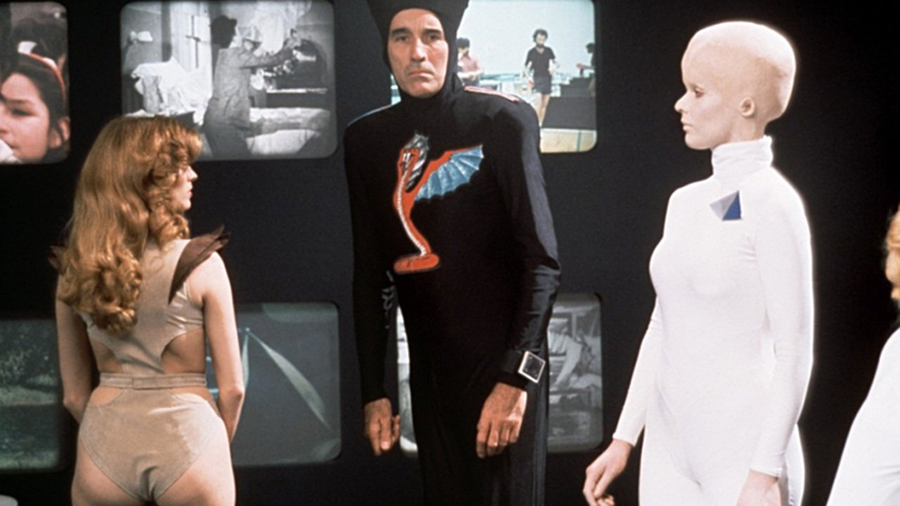 Aliens wars on Earth - (l ro r) Gezeth (Victoria Johnson), Captain Ramses (Christopher Lee) and Phi (Tiiu Leek) in Starship Invasions (1977)